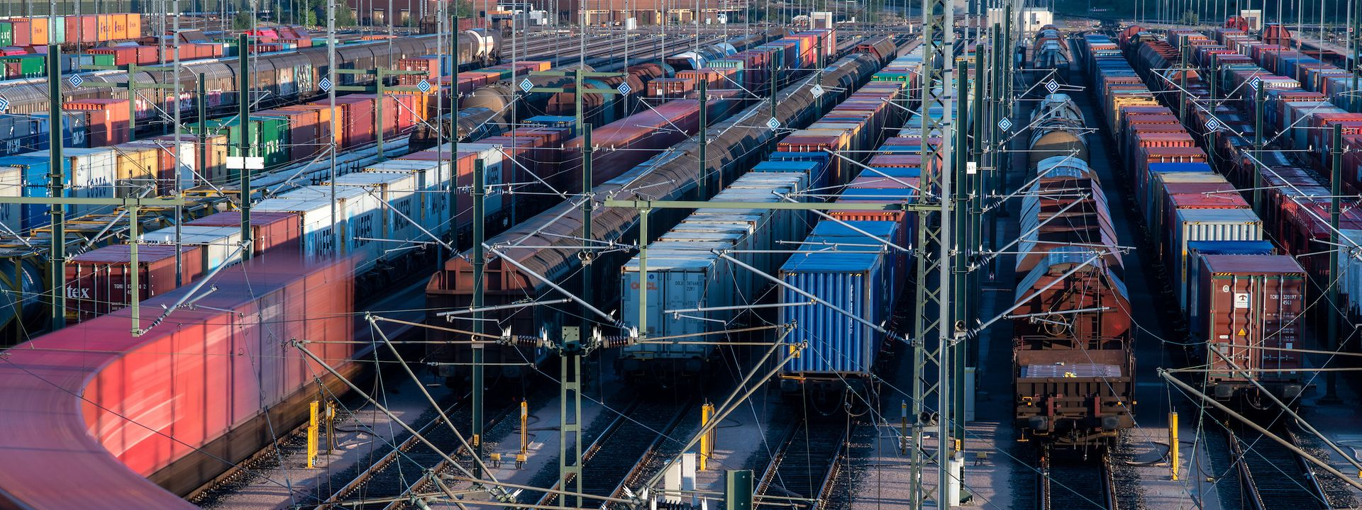Trains at rail freight station.