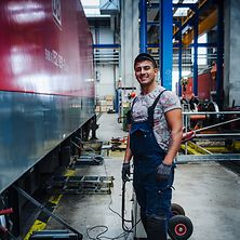 Young worker in train garage