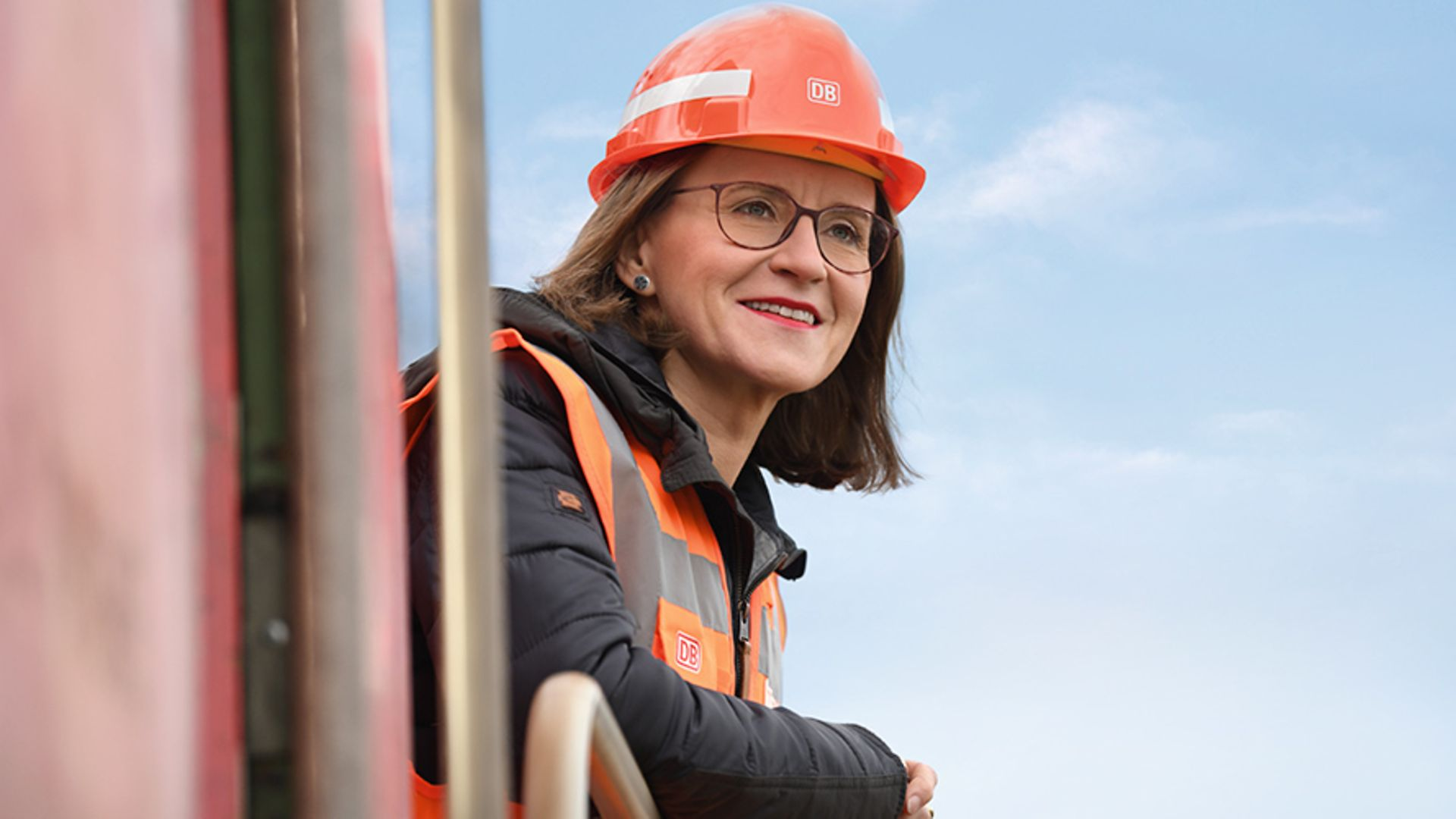 DB Cargo Head of Bord Board Dr. Sigrid Nikutta watching out of a lokomotive wearing safety clothes